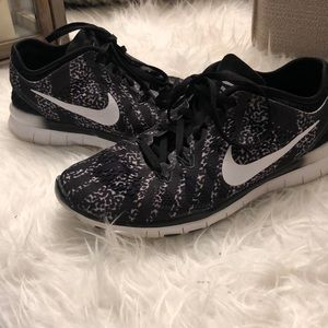 Shoes - Black and White Nike Free 5.0 sneakers
